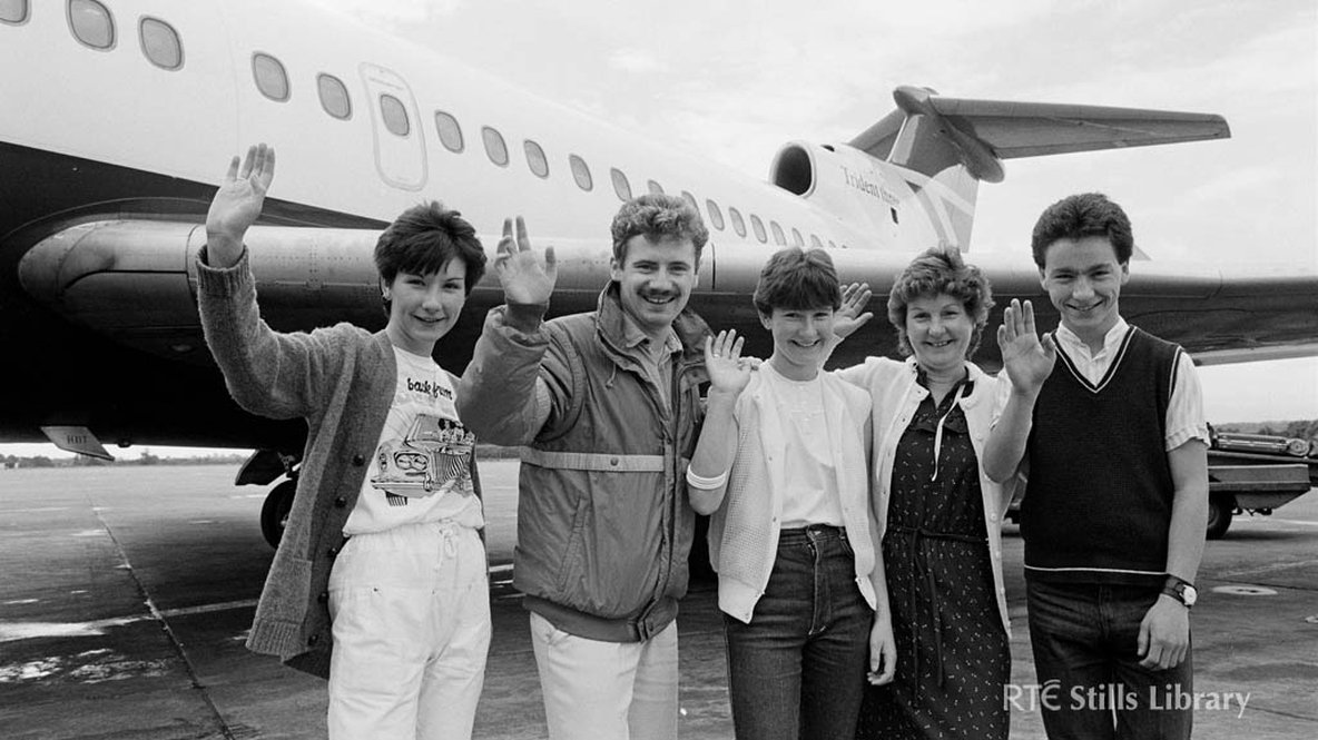 Presenter Barry Lang (second left) with 'Poparama' competition winners in 1984, but who are they?