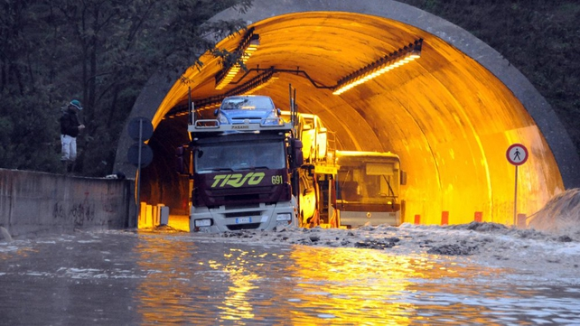 A tunnel entrance near Nuoro is blocked by floodwaters