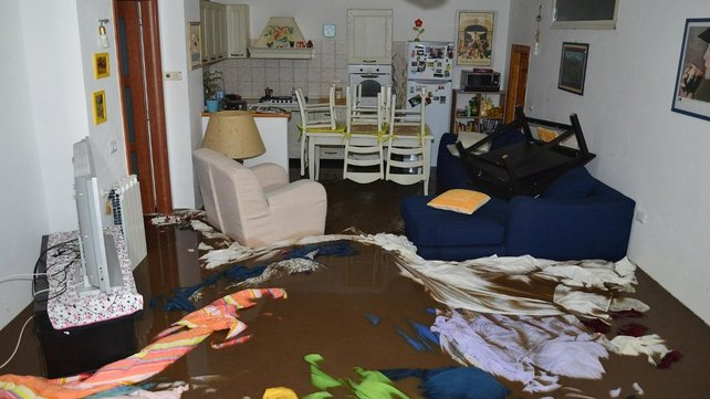 Floodwaters rushed through people's homes