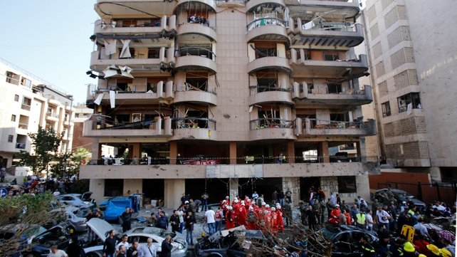Lebanese soldiers and emergency personnel gather at the blast site in Bir Hassan neighbourhood