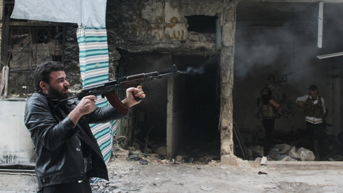 A rebel fighter from the Free Syrian Army fires his weapon during fighting against government forces in the Salah al-Din neighbourhood of the northern Syrian city of Aleppo