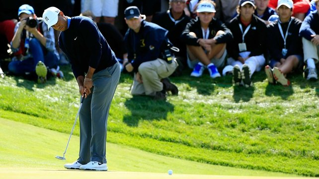 Tiger Woods suffered a two-stroke penalty at the BMW Championship after he tried to remove a twig from behind his ball