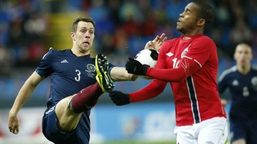 Norway's Ola Kamara and Scotland's Steven Whittaker vie for possession