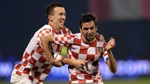 Darijo Srna celebrates scoring Croatia's second goal against Iceland