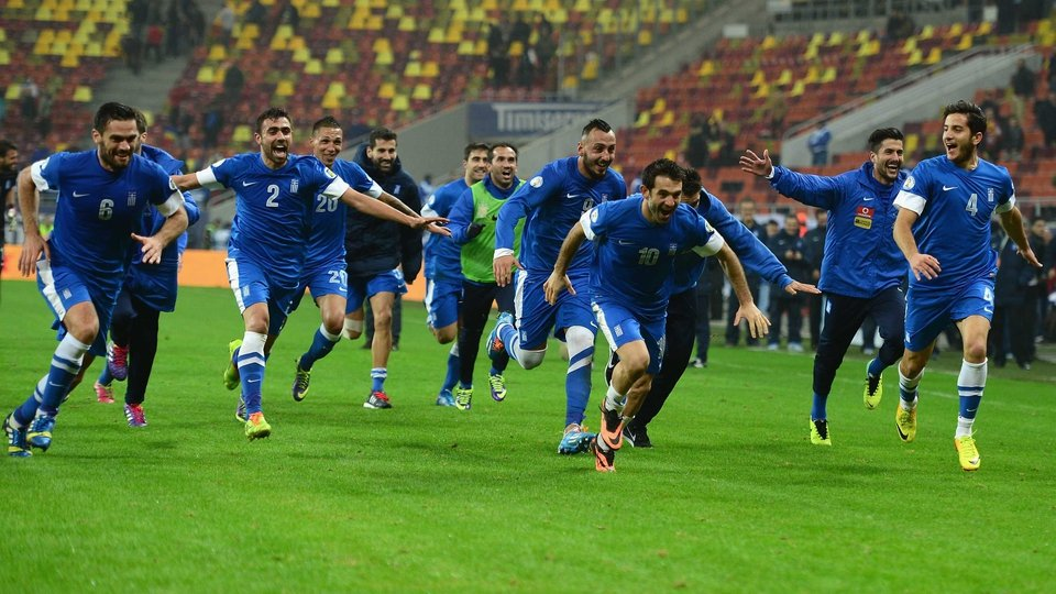 Greece players celebrate their qualification for the 2014 World Cup after a 4-2 aggregate win over Romania