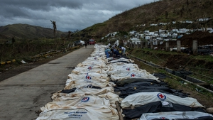 Bodies on the roadside in the Tacloban region, awaiting burial
