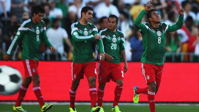 Juan Carlos Medina celebrates Mexico's fourth goal of the match