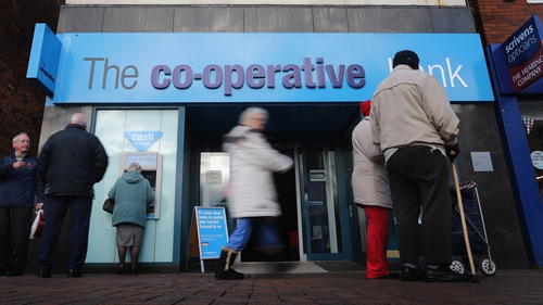 The Co-op banking arm warns that legacy issues will continue to hit its financial performance for some time