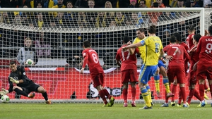 Zlatan Ibrahimovic scores his and Sweden's second goal during their 3-2 loss to Portugal in the Friends Arena in Stockholm