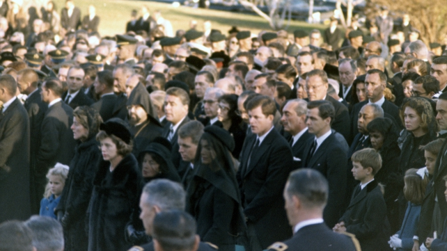 The Kennedy family gathered at the graveside in Arlington (Pic: Cecil Stoughton. White House Photographs. John F Kennedy Presidential Library and Museum, Boston)