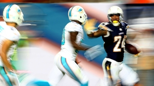 Ryan Mathews (r) of the San Diego Chargers runs with the ball against the Miami Dolphins during their game at Sun Life Stadium in Miami Gardens