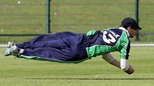 Alex Cusack of Ireland takes a diving catch against the USA in the World Cup Twenty20 Qualifiers in Abu Dhabi