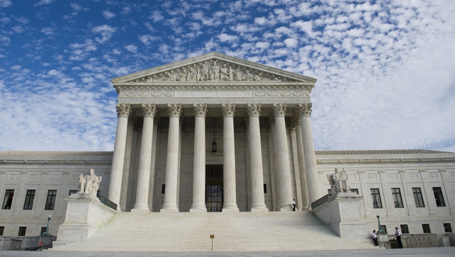 The nine-member court will weigh whether for-profit corporations may raise religious objections