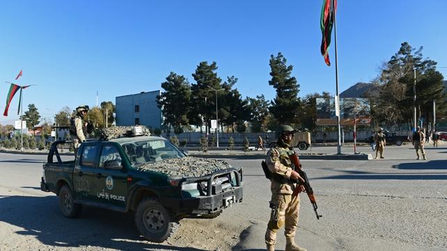 Afghan policemen stand guard near the premises where the Loya Jirga will be held