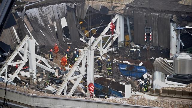 Rescue workers worked to clear the wreckage
