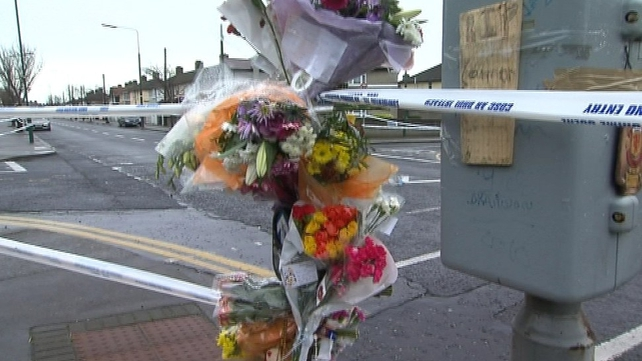 Flowers placed near the spot where Conor Hickey was killed