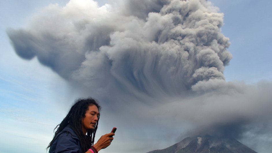 Hot smoke spews from Mount Sinabung in the Karo district on the north of Indonesia's Sumatra island