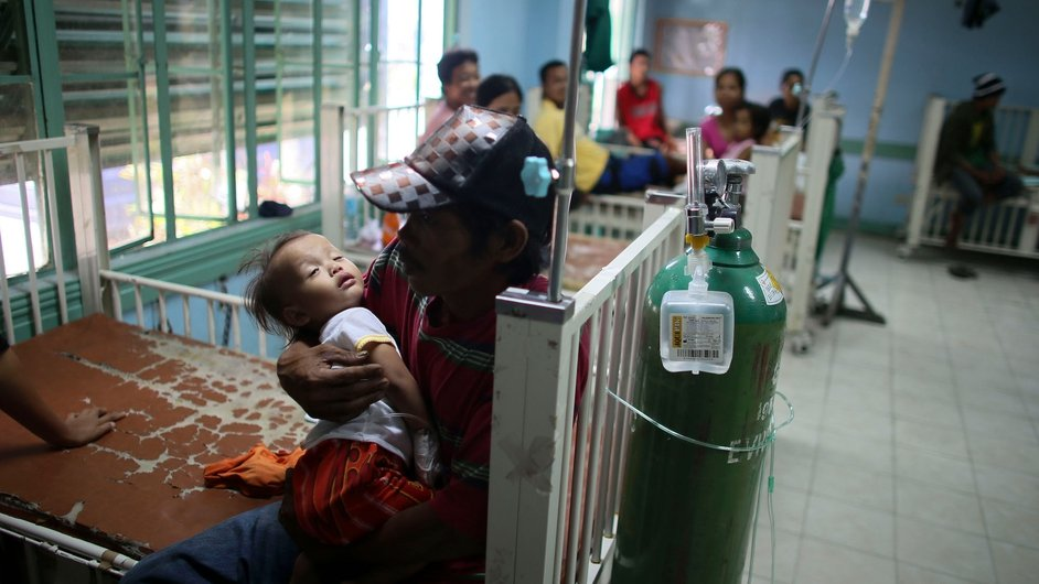 Roberto Graberino, 2, waits for treatment for a lung infection in a paediatric ward in the devastated city of Tacloban