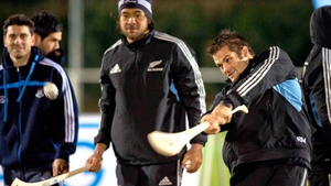 New Zealand rugby captain Richie McCaw tries his hand at hurling during a promotional event in Dublin