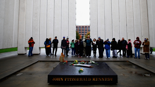 People visit the John F. Kennedy Memorial Plaza in Dallas, Texas