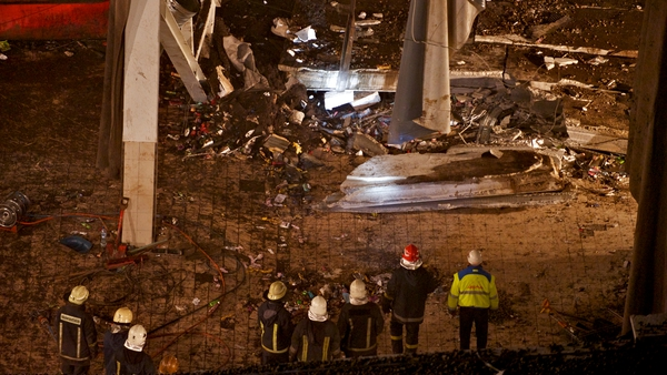 Rescuers at the ruins of the Maxima supermarket in Riga where at least 54 died after the roof collapsed