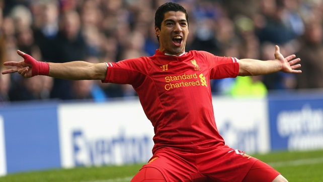 Luis Suarez celebrates after scoring a spectacular goal from his free-kick