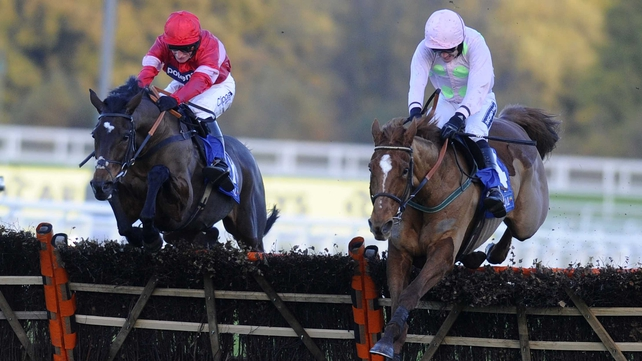 Ruby Walsh riding Annie Power (R) clear the last to win from Zarkandar