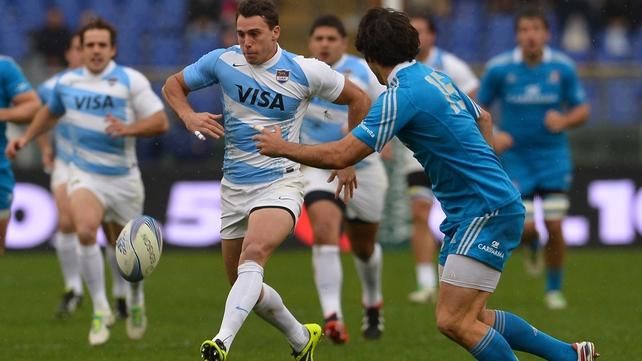 Argentinian winger Juan Imhoff (c) kicks the ball as Italy's fullback Luke McLean looks on