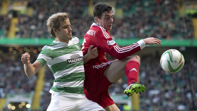 Celtic's Teemu Pukki (l) and Aberdeen's Joe Shauhnessy battle for the ball