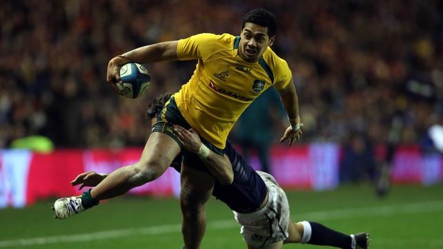 Scotland's Sean Maitland tries but fails to stop Chris Feauai-Sautia from touching down for Australia