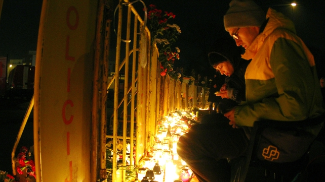 Mourners leave candles outside Maxima supermarket in Riga where the roof collapsed killing at least 54