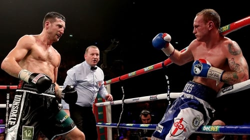 Carl Froch (l) rocks George Groves on his way to retaining his world titles