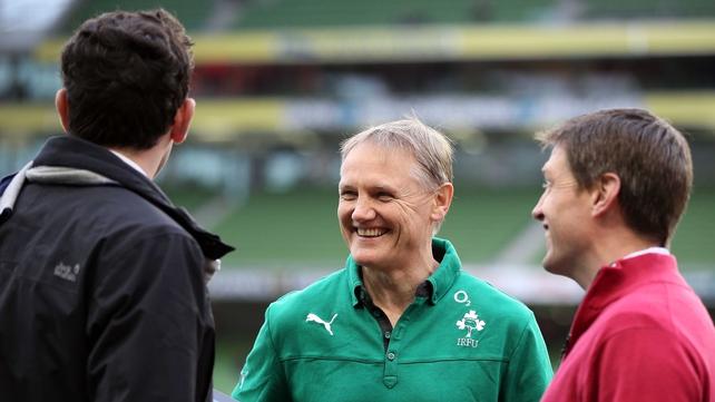 Ireland head coach Joe Schmidt chews the fat with former internationals Shane Horgan (left) and Ronan O'Gara (right) prior to today's match