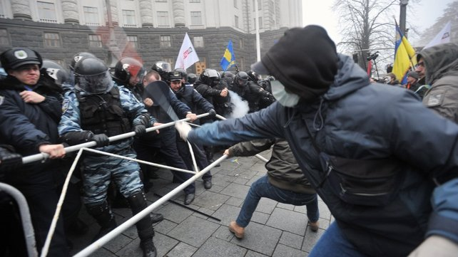 Pro-EU supporters clash with police outside government buildings in Kiev over the scrapped EU deal