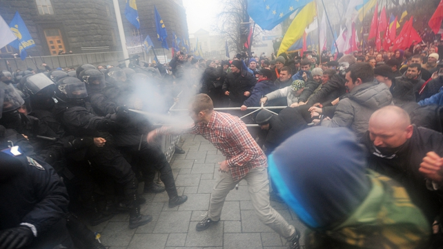 Clashes as rally in central Kiev turns violent on protest against government scrapping deal with EU