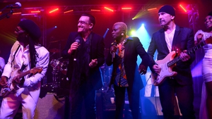 Bono gets down with Nile and The Edge for some karaoke