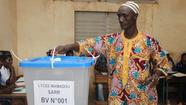 A man casts his vote at a polling station in Bamako, Mali