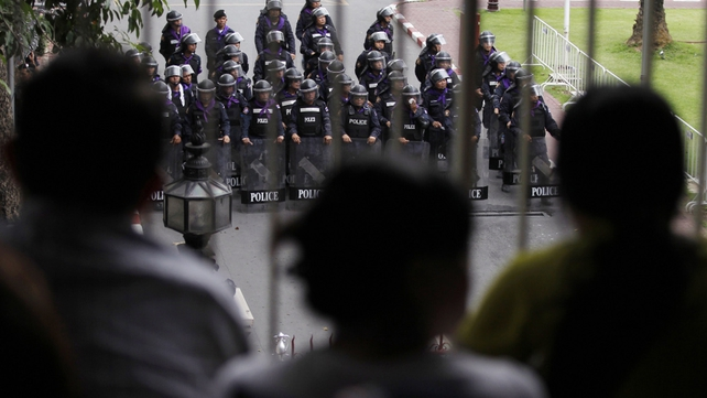 Police stand guard outside government buildings