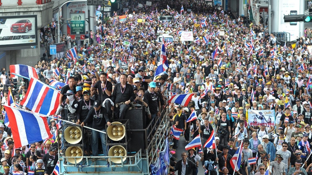 Over 30,000 people have taken to the streets of the Thai capital