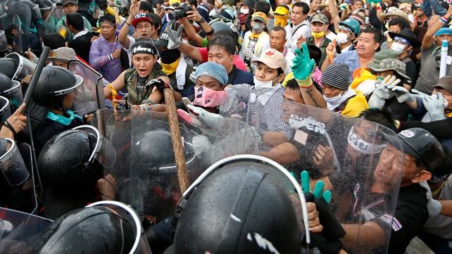 Anti-government protesters confront police