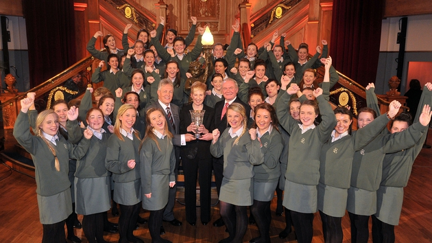 The students of Presentation College, Ballyphehane and Choir Director Anne Dunphy received their trophy from the First Minister and the Deputy First Minister of Northern Ireland, Peter Robinson and Martin McGuinness