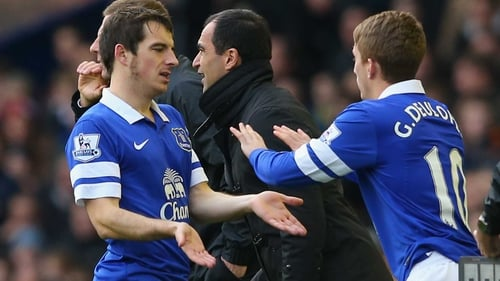 Baines (l) was forced off early in the second half against Liverpool