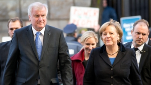 CSU chairman Horst Seehofer (L), and Angela Merkel arrive at SPD headquarters for coalition talks
