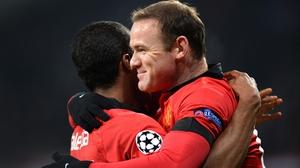 Opening goalscorer Antonio Valencia celebrates with Wayne Rooney