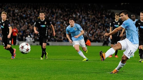 Sergio Aguero opens the scoring from the penalty spot for Manchester City