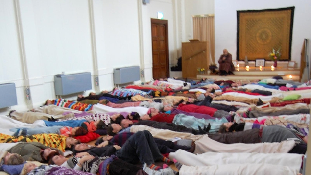 120 of us bedded down with blankets in what looked like a giant slumber party