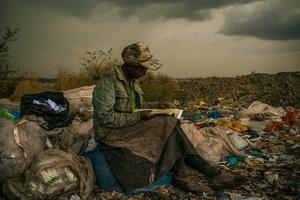 Woman Reading at Dandora Municipal Dump, Nairobi, Kenya  (Micah Albert, USA, Redux Images for Pulitzer Center on Crisis Reporting)