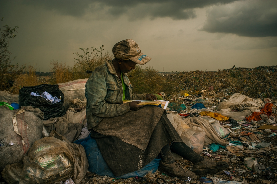 Woman Reading at Dandora Municipal Dump, Nairobi, Kenya  (Micah Albert, USA, Redux Images for Pulitzer Center on Crisis Reporting)