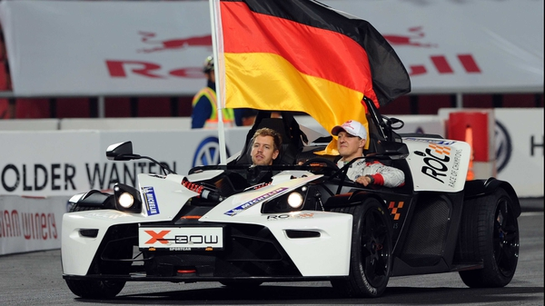 Michael Schumacher and Sebastian Vettel race together at the annual race of Champions event as Team Germany