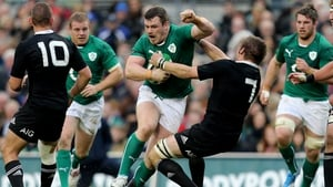 Ireland's Cian Healy swats aside New Zealand captain Richie McCaw during the game at Lansdowne Road